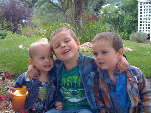 Eli, Linc, and Evie in garden
